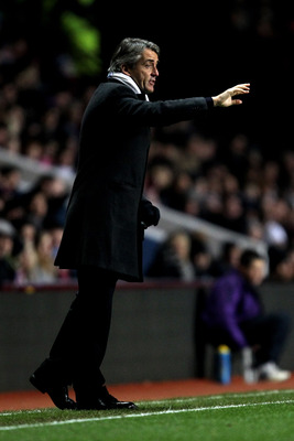 BIRMINGHAM, ENGLAND - JANUARY 22:  Roberto Mancini the Manchester City manager directs his players during the Barclays Premier League match between Aston Villa and Manchester City at Villa Park on January 22, 2011 in Birmingham, England.  (Photo by Ian Wa