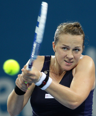 BRISBANE, AUSTRALIA - JANUARY 06:  Anastasia Pavlyuchenkova of Russia plays a backhand during her quarter final match against Lucie Safarova of the Czech Republic during day five of the Brisbane International at Queensland Tennis Centre on January 6, 2011