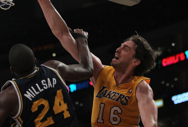 LOS ANGELES, CA - JANUARY 25:  Pau Gasol #16 of the Los Angeles Lakers dunks over Paul Millsap #24 of the Utah Jazz in the second half at Staples Center on January 25, 2011 in Los Angeles, California. The Lakers defeated the Jazz 120-91. NOTE TO USER: Use