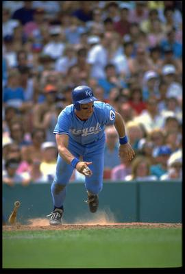 1990:  KANSAS CITY ROYALS INFIELDER GEORGE BRETT RUNS TO FIRST BASE AFTER MAKING CONTACT WITH A PITCH DURING THE ROYALS GAME AT ROYALS STADIUM IN KANSAS CITY, MISSOURI.