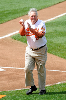 BALTIMORE - APRIL 09:  Brooks Robinson waves to the crowd after throwing out the first pitch before the game between the Baltimore Orioles and the Toronto Blue Jays on Opening Day at Camden Yards on April 9, 2010 in Baltimore, Maryland.  (Photo by Greg Fi