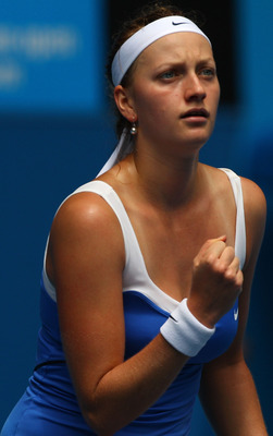 MELBOURNE, AUSTRALIA - JANUARY 24:  Petra Kvitova of the Czech Republic celebrates a point in her fourth round match against  Flavia Pennetta of Italyduring day eight of the 2011 Australian Open at Melbourne Park on January 24, 2011 in Melbourne, Australi