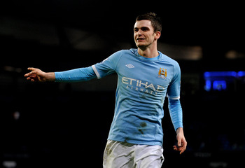 MANCHESTER, UNITED KINGDOM - JANUARY 18:   Adam Johnson of Manchester City celebrates scoring his team's third goal during the FA Cup sponsored by E.On Third Round Replay match between Manchester City and Leicester City at the City of Manchester Stadium o