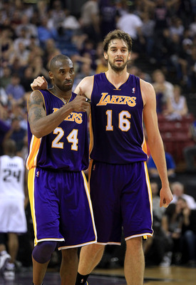 SACRAMENTO, CA - NOVEMBER 03:  Kobe Bryant #24 and Pau Gasol #16 of the Los Angeles Lakers walk off the court for halftime after the Lakers made a last second shot against the Sacramento Kings at ARCO Arena on November 3, 2010 in Sacramento, California.