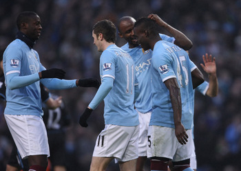 MANCHESTER, ENGLAND - DECEMBER 28:  Mario Balotelli of Manchester City celebrates with Patrick Viera after scoring his first goal during the Barclays Premier League match between Manchester City and Aston Villa at the City of Manchester Stadium on Decembe