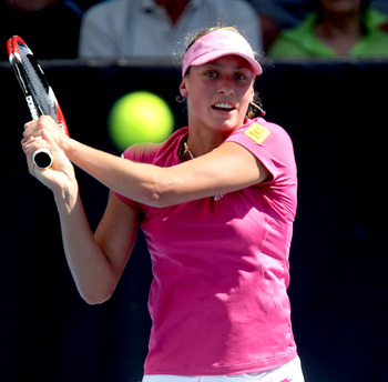 AUCKLAND, NEW ZEALAND - JANUARY 05:  Yanina Wickmayer of Belguim plays a backhand during her match against Sabine Lisicki of Germany on day three of the ASB Classic at the ASB Tennis Centre on January 5, 2011 in Auckland, New Zealand.  (Photo by Phil Walt
