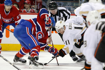 MONTREAL, CANADA - JANUARY 22:  Saku Koivu #11 of the Anaheim Ducks faces off against Scott Gomez #11 of the Montreal Canadiens during the NHL game at the Bell Centre on January 22, 2011 in Montreal, Quebec, Canada.  (Photo by Richard Wolowicz/Getty Image