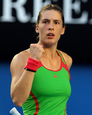 MELBOURNE, AUSTRALIA - JANUARY 23:  Andrea Petkovic of Germany celebrates winning a point in her fourth round match against Maria Sharapova of Russia during day seven of the 2011 Australian Open at Melbourne Park on January 23, 2011 in Melbourne, Australi