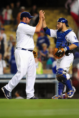 LOS ANGELES, CA - AUGUST 18: Jonathan Broxton #51 and Russell Martin #55 of the Los Angeles Dodgers Celebrate their win  against the St. Louis Cardinals at Dodger Stadium on August 18, 2009 in Los Angeles, California. The Dodgers defeated the Cardinals 7-
