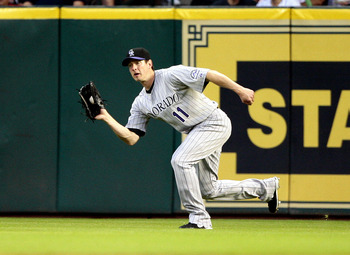 HOUSTON - MAY 19:  Right fielder Brad Hawpe #11 of the Colorado Rockies makes a catch on a dipping fly ball against the Houston Astros at Minute Maid Park on May 19, 2010 in Houston, Texas.  (Photo by Bob Levey/Getty Images)