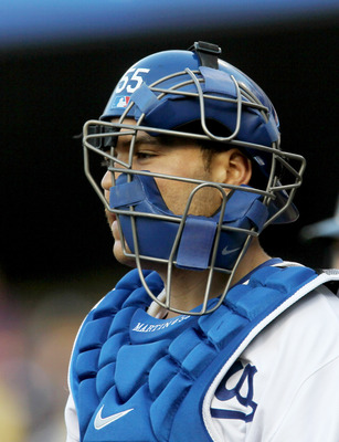 LOS ANGELES - JULY 5: Catcher Russell Martin of the Los Angeles Dodgers stands with his mask askew after his throwing error allowed a run to score in the second inning against the Florida Marlins on July 5, 2010 at Dodger Stadium in Los Angeles, Californi