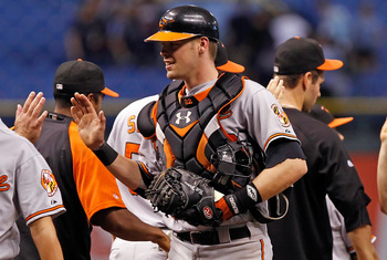 ST. PETERSBURG - SEPTEMBER 27:  Catcher Matt Wieters #32 of the Baltimore Orioles is congratulated after a victory over the Tampa Bay Rays at Tropicana Field on September 27, 2010 in St. Petersburg, Florida.  (Photo by J. Meric/Getty Images)