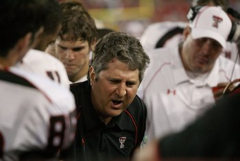 HOUSTON - SEPTEMBER 26: Head coach Mike Leach of the Texas Tech Red Raiders talks with his defense while playing against the University of Houston at Robertson Stadium on September 26, 2009 in Houston, Texas.  (Photo by Thomas B. Shea/Getty Images)