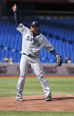 TORONTO - SEPTEMBER 23:   Felix Hernandez #34 of the Seattle Mariners points to a fly ball during the game against the Toronto Blue Jays on September 23, 2010 at Rogers Centre in Toronto, Ontario, Canada. The Blue Jays defeated the Mariners 1-0. (Photo by