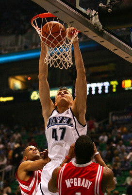 SALT LAKE CITY - MAY 03:  Andrei Kirilenko #47 of the Utah Jazz dunks in front of Shane Battier #31 and Tracy McGrady #1 of the Houston Rockets in the first quarter during Game Six of the Western Conference Quarterfinals during the 2007 NBA Playoffs at th
