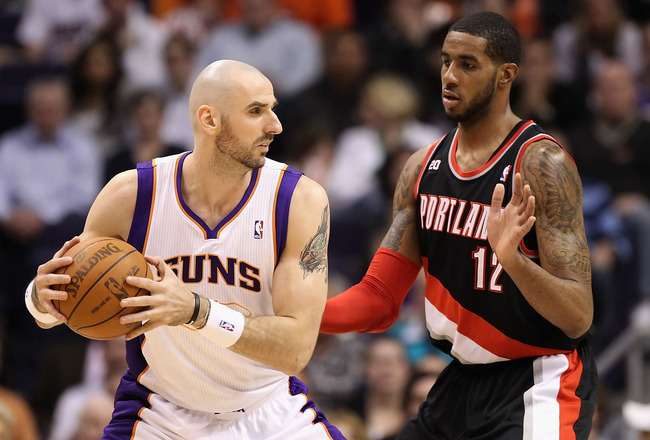 PHOENIX, AZ - JANUARY 14:  Marcin Gortat #4 of the Phoenix Suns looks to pass against LaMarcus Aldridge #12 of the Portland Trail Blazers during the NBA game at US Airways Center on January 14, 2011 in Phoenix, Arizona. The Suns defeated the Trail Blazers