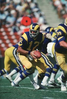 Quarterback Joe Namath of the LA Rams drops back in the pocket to turn the hand off during a game at the LA Memorial Coliseum in Los Angeles, California.