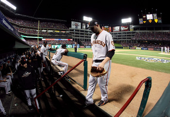 ARLINGTON, TX - OCTOBER 30:  Starting pitcher Jonathan Sanchez #57 of the San Francisco Giants walks into the dugout dejected after he was taken out of the game in the bottom of the fifth inning against the Texas Rangers in Game Three of the 2010 MLB Worl