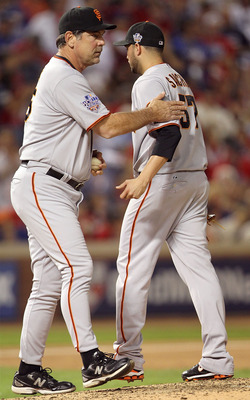ARLINGTON, TX - OCTOBER 30:  Manager Bruce Bochy (L) of the San Francisco Giants takes starting pitcher Jonathan Sanchez #57 out of the game in the bottom of the fifth inning against the Texas Rangers in Game Three of the 2010 MLB World Series at Rangers