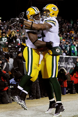 PHILADELPHIA, PA - JANUARY 09:  Andrew Quarless #81 of the Green Bay Packers  celebrates Brandon Jackson #32 after a touchdown in the third quarter against the Philadelphia Eagles during the 2011 NFC wild card playoff game at Lincoln Financial Field on Ja
