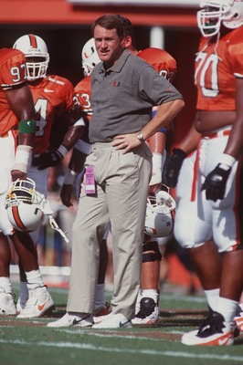 28 Oct 1995: Head coach Butch Davis of the Miami Hurricanes stands on the field amongst his players as he observes pre game warm ups before the Hurricanes 36-12 victory over the Temple Owls at the Orange Bowl in Miami, Florida.