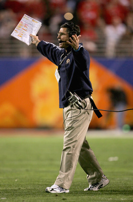 TEMPE, AZ - JANUARY 1:  Pittsburgh head coach, Walt Harris, yells to his team from the sidelines during the Tostito's Fiesta Bowl against Utah at the Sun Devil Stadium on January 1, 2005 in Tempe, Arizona. (Photo by Jeff Gross/Getty Images).