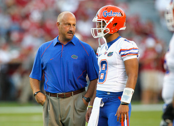 TUSCALOOSA, AL - OCTOBER 02:  Offensive coordinator Steve Addazio converses with quarterback Trey Burton #8 of the Florida Gators during pregame warmups before facing the Alabama Crimson Tide at Bryant-Denny Stadium on October 2, 2010 in Tuscaloosa, Alaba