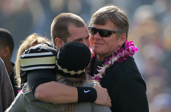 BOULDER, CO - NOVEMBER 20:  Quarterback Cody Hawkins #7 of the Colorado Buffaloes is welcomed to the field by family members including his father Dan Hawkins (R) on senior day prior to facing the Kansas State Wildcats at Folsom Field on November 20, 2010
