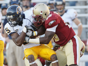 CHESTNUT HILL, MA - SEPTEMBER 11:  Anthony Bowman Jr. #26 of the Kent State Golden Flashes is tackled by Dominick LeGrande #26 of the Boston College Eagles on September 11, 2010 at Alumni Stadium in Chestnut Hill, Massachusetts. Boston College defeated Ke