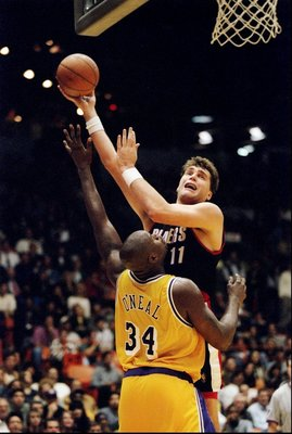 13 Dec 1996: Center Arvydas Sabonis of the Portland Trail Blazers (right) goes up for two as Los Angeles Lakers center Shaquille O''Neal covers him during a game at the Great Western Forum in Inglewood, California. The Lakers won the game, 120-119. ++++