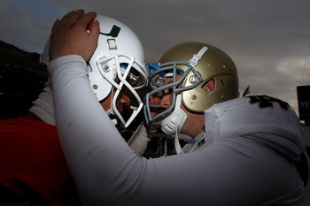 EL PASO, TX - DECEMBER 30:  (L-R) Stephen Morris #17  of the Miami Hurricanes hugs Tommy Rees #13 of the Notre Dame Fighting Irish at Sun Bowl on December 30, 2010 in El Paso, Texas.  (Photo by Ronald Martinez/Getty Images)