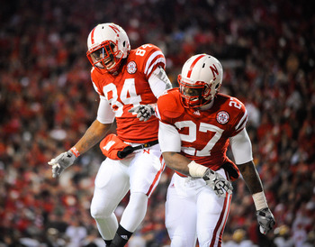 LINCOLN, NE - NOVEMBER 26: Dontrayevous Robinson #27 and Brandon Kinnie #84 of the Nebraska Cornhuskers celebrate a touchdown during their game against the Colorado Buffaloes at Memorial Stadium on November 26, 2010 in Lincoln, Nebraska. Nebraska defeated