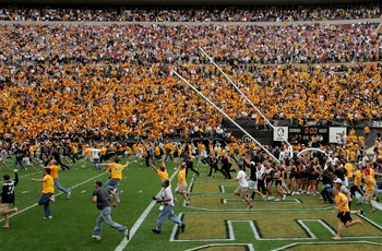 BOULDER, CO - SEPTEMBER 29:  The goal posts are lowered as the fans swarm the field after place kicker Kevin Eberhart of the Colorado Buffaloes kicked the game winning field goal as time expires against the Oklahoma Sooners at Folsom Field on September 29