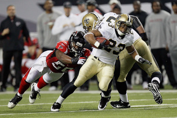 ATLANTA, GA - DECEMBER 27:  Pierre Thomas #23 of the New Orleans Saints runs upfield in the first half during the game against the Atlanta Falcons at the Georgia Dome on December 27, 2010 in Atlanta, Georgia.  (Photo by Kevin C. Cox/Getty Images)