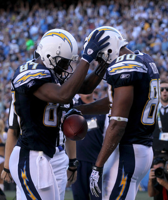 SAN DIEGO - DECEMBER 12:  Wide receivers Malcom Floyd #80 and Kelley Washington #87 of the San Diego Chargers celebrate after Floyd's nine yard touchdown catch against the Kansas City Chiefs at Qualcomm Stadium on December 12, 2010 in San Diego, Californi