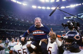 NEW ORLEANS - JANUARY 26:  Defensive coordinator Buddy Ryan of the Chicago Bears gets carried off the field by defensive lineman Richard Dent #95 and teammate as they celebrate their victory over the New England Patriots in Super bowl XX at Louisiana Supe