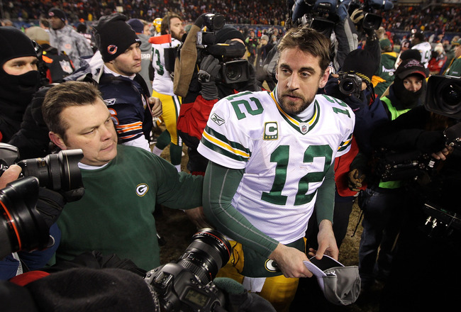 CHICAGO, IL - JANUARY 23:  Quarterback Aaron Rodgers #12 of the Green Bay Packers stands by Jay Cutler #6 of the Chicago Bears after the Packers 21-14 victory against the Bears in the NFC Championship Game at Soldier Field on January 23, 2011 in Chicago,