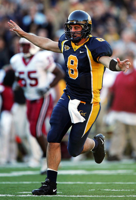 BERKELEY, CA - NOVEMBER 20:  Aaron Rodgers #8 of the California Golden Bears celebrates after throwing a touchdown pass to Burl Toeler against the Stanford Cardinals at Memorial Stadium on November 20, 2004 in Berkeley, California.  (Photo by Jed Jacobsoh