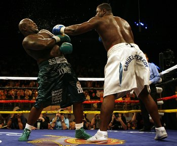 HOLLYWOOD, FL - JANUARY 06:  Samuel 'Nigerian Nightmare' Peter (R) exchanges punches during his victory by decission against James ' Lights Out' Toney in a WBC heavyweight title eliminator fight at the Hard Rock Hotel and Casino January 6, 2007 in Hollywo