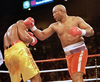 5 Nov 1995:  George Foreman trows a left punch at Michael Moorer during the fight in Las Vegas. Forman wins by a knock out in round 10. Mandatory Credit: Al Bello  /Allsport