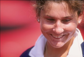 20 Aug 1995:  Monica Seles of Yugoslavia looks on during her match against Amanda Coetzer of South Africa in the Canadian Open.  Seles won the match. Mandatory Credit: Matthew Stockman  /Allsport