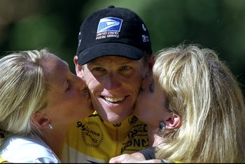 25 Jul 1999:  Lance Armstrong of USA and the US Postal team is kissed by first wife Kristen and mother Linda after winning the 1999 Tour de France on stage 20 between Arpajon and Paris, France.  \ Mandatory Credit: Tom Able-Green /Allsport