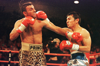 7 Apr 2001:  Marco Antonio Barrera of Mexico lands a punch against Prince Naseem Hamed of Great Britain during their bout at the MGM Grand Garden Arena in Las Vegas, Nevada. Mandatory Credit: Al Bello/ALLSPORT