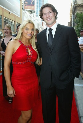 TORONTO, ON - JUNE 14:  WWF Wrestler Trish Stratus and Shane Doan of the Phoenix Coyotes arrive to the 2007 NHL Awards at the Elgin Theatre on June 14, 2007 in Toronto, Ontario.  (Photo by Dave Sandford/Getty Images)