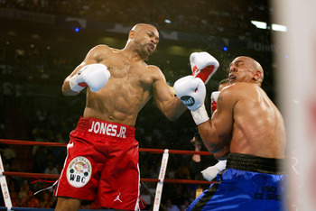 02 Feb 2002:   Roy Jones Jr (L) lands a powerful left hook to the face of Glen Kelly during the Lightheavyweight bout at American Airlines Arena in Miami, Florida. Roy Jones Jr. won by KO in the 7th. DIGITAL IMAGE. Mandatory Credit: Eliot Schechter/Getty