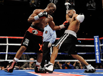 LAS VEGAS - APRIL 03:  Bernard Hopkins (L) hits Roy Jones Jr. during the 11th round of their light heavyweight bout at the Mandalay Bay Events Center April 3, 2010 in Las Vegas, Nevada. Hopkins won by unanimous decision.  (Photo by Ethan Miller/Getty Imag