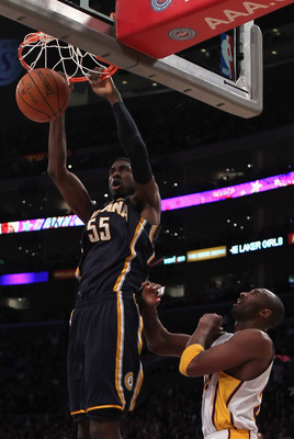 LOS ANGELES, CA - NOVEMBER 28:  Roy Hibbert #55 of the Indiana Pacers dunks the ball over Kobe Bryant #24 of the Los Angeles Lakers during the fourth quarter at Staples Center on November 28, 2010 in Los Angeles, California. The Pacers defeated the Lakers