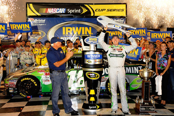 BRISTOL, TN - AUGUST 21:  Kyle Busch, driver of the #18 Doublemint Toyota, poses in Victory Lane after winning the NASCAR Sprint Cup Series IRWIN Tools Night Race at Bristol Motor Speedway on August 21, 2010 in Bristol, Tennessee.  (Photo by John Harrelso