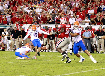 JACKSONVILLE, FL - OCTOBER 30:  Chas Henry #17 of the Florida Gators attempts a game winning field goal against the Georgia Bulldogs at EverBank Field on October 30, 2010 in Jacksonville, Florida.  (Photo by Sam Greenwood/Getty Images)