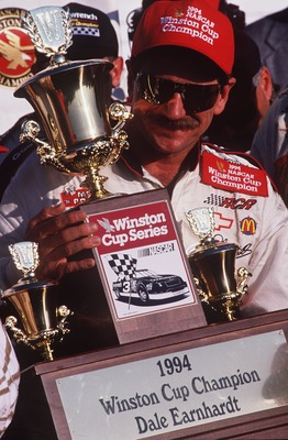 ROCKINGHAM, NC - OCTOBER 23:  Dale Earnhardt driver of the #3 GM Goodwrench Cheverolet poses with the NASCAR Winston Cup championship trophy after winning the AC Delco 500 on October 23, 1994 at the North Carolina Motor Speedway in Rockingham, North Carol